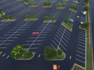 What is the Process for Sealcoating Asphalt? » Alpha Paving